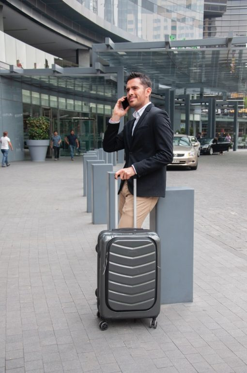 business travel with suitcase