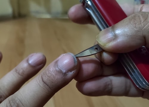 SAK Awl for cleaning fingernail